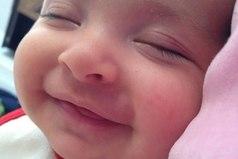 Говорят когда во сне ребёнок улыбается, с ним ангел играет..!